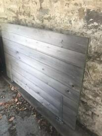 Wooden gate with hinges.