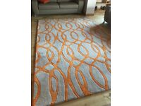 Large beige and orange rug