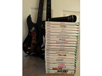 wii games bundle. 2 guitars. 1 microphone and 21 games/discs ,including guitar hero and we sing