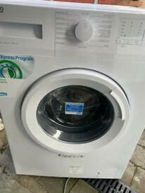 NEW Beko washing machine. With manufacturers warranty large 8kg load. Can drop off free if local