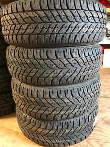 Good Year 235/55R18 studded winter tires. 235 55 18