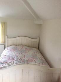 Cream double bed