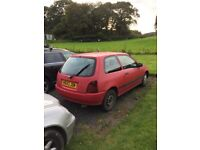 Car - red Toyota starlet