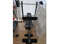 Weigjt bench with bar bell and dumbell selection of weights great condition