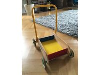 Brightly coloured baby walker