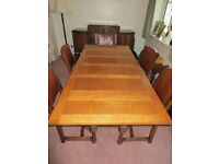 Antique Oak dining suite with large table, 5 chairs and sideboard. Good condition REDUCED!!
