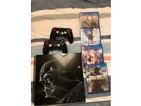1tb PS4 death Vader console and extra controller and games.