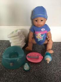 Baby born interactive boy doll with accessories