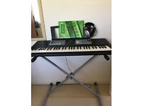 Yamaha PSRE233 keyboard (61 keys) with stand for sale. Not used much.