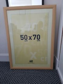 2 wooden and glass frames