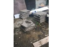 Around 30 used paving slabs for sale