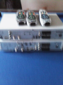 two sky set top boxes (not HD) and 3 sky remote controllers.