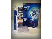 Oral B Pro 4000 CrossAction Electric Rechargeable Toothbrush Braun & 4 of 3D White Replacement Head