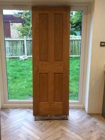 oak veneer 4 panel Victorian door, used.