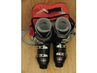 Pair of ski boots with bag