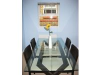 Glass topped with Wood dining table and four chairs