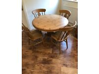 Pine Table with 4 chairs.