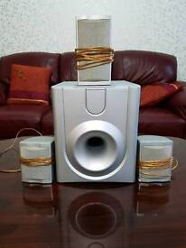 Grey speakers and subwoofers