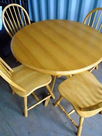 solid pine round table & 4 matching chairs.