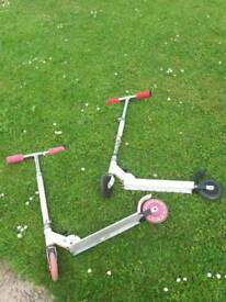 Pink folding Scooter, red and white Zinc Fuse scooter with sparking brake