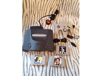 Nintendo 64 console with 3 games