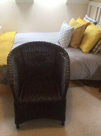Ikea brown wicker armchair.