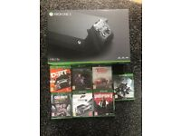 Xbox one X like new 7 games. Hardly used