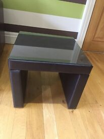 Brown side table with glass top
