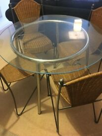 Glass round table and four chairs