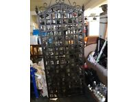 Wrought iron wine rack. Holds 66 bottles