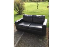 Black leather sofa bed in good used condition.