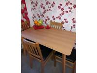Oak coloured dining table and 4 chairs