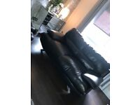 Black leather Harvey's sofa 3 plus 2 seater and matching footstool