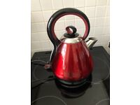 Red Russell Hobbs kettle and tea coffee sugar jars