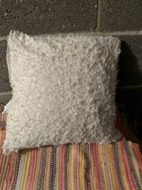 Free cream fluffy cushion. Good condition. Still available, collect tonight
