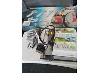 Nintendo wii and accessories. wii remotes x2