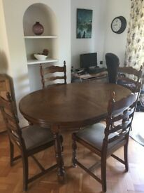 Oak extending table with 6 chairs