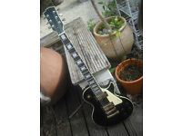 Unbranded Les Paul style electric guitar with Lawsuit type open book headstock
