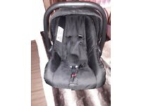 Tutti Bambini Black Car Seat age 0-12 Months. In good condition