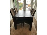 Extendable dining table (French wood) and 4 Cabana Loom leather chairs