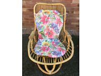 TWO CANE ROCKING CHAIRS COMPLETE WITH CUSHION PLUS ONE CANE CHAIR .
