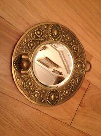 Small gold mirror