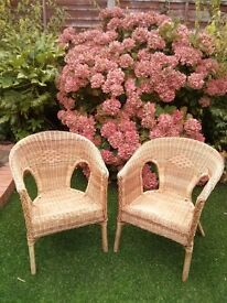 A pair of wicker chair