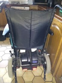Electric wheelchair with powerpack and lead.