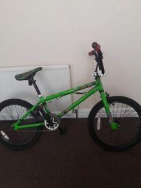 Pink and green bmx bike