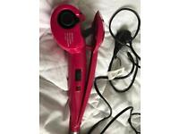 Brand new! BaByliss curling tongs.