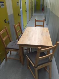 Light coloured wood dining table and matching chairs x4