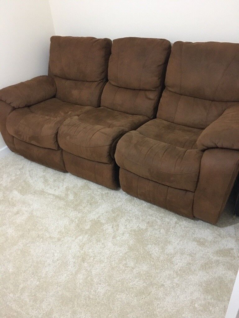 Beautiful four seater Brown Sofa Only £150