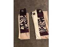 Cream/purple pair of curtains