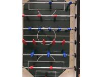 Coin-operated table football table.